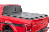 Image Toyota Hard Tri-Fold Bed Cover (16-18 Tacoma - 5' Bed w/Cargo Mgmt)