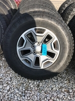 """Image Five Jeep JKU Rubicon 17"""" Gray aluminum wheels with Nitto G2 tires"""