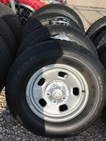 """Image Four Ram 1500 17"""" Steel wheels with tires"""