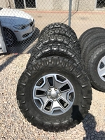 """Image Five Jeep JKU Rubicon 17"""" wheels with Nitto M/T tires"""