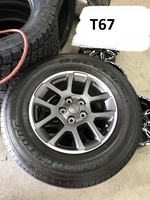 """Image Four Jeep Gladiator JT 18"""" gray and milled aluminum wheels with tires"""