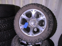 """Image Four Ram 1500 20"""" Chrome wheels with tires"""